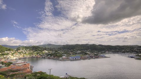 HDR Time lapse St Georges Bay in Grenada with clouds passing by