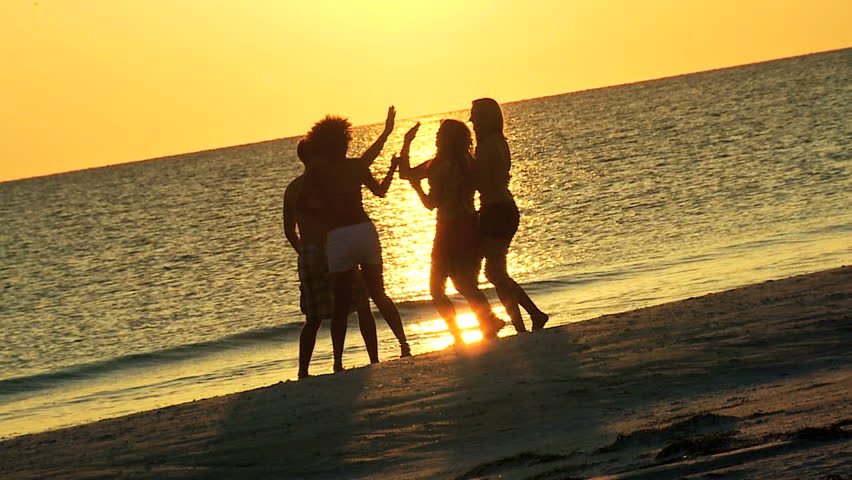 Group Carefree Boy Girl Teenagers Casual Beachwear Enjoying Beach Ocean At Sunset On Vacation Together Shot