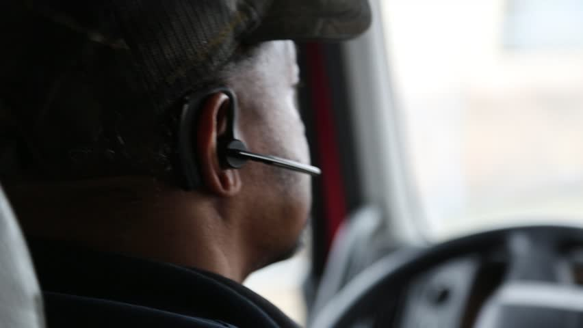 Dallas, Texas, Circa 2014: Closeup of driver of tractor trailer as he positions his truck for unloading in Dallas, Texas, Circa 2014