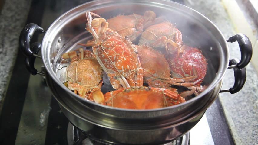 Crabs stream cooking in kitchen, 4K