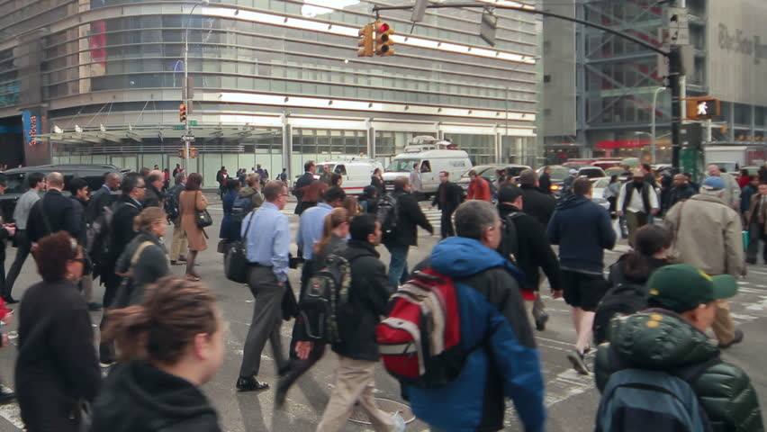 NEW YORK CITY - APRIL 3, 2014: Crowd of commuter people walking crossing street intersection