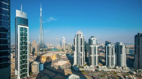 DUBAI, UAE - MARCH 28, 2014: Panoramic view of Burj Khalifa tower from day to night,  the tallest man-made structure in the world, at 829.8 m (2,722 ft). Time lapse movie.