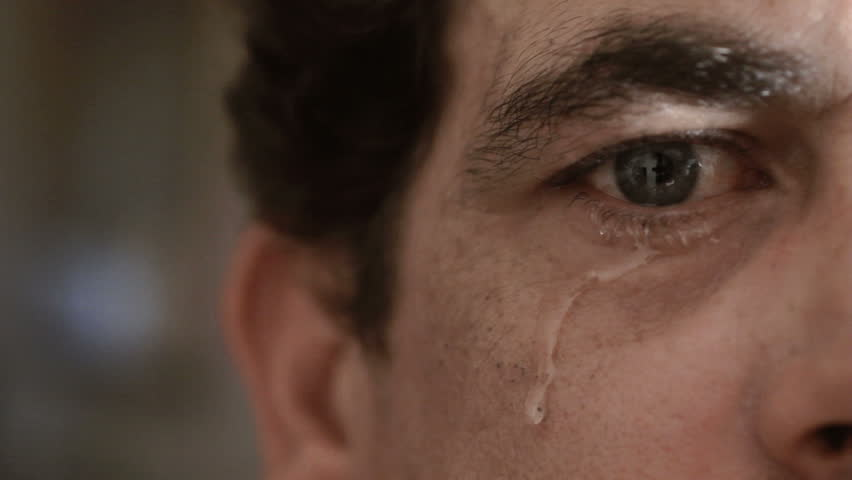 Crying man with tears in eye closeup | Shutterstock HD Video #6049241