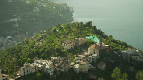 Wide Shot PAN View of coastal cliffs with scattered houses / Ravello, Campania, Italy