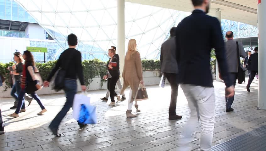 MILANO, ITALY - APRIL 10, 2014: People walk to the pavilions under the Fiera gallery to Salone del Mobile, international home furnishing and accessories design exhibition in Milano, Italy.  | Shutterstock HD Video #6080384