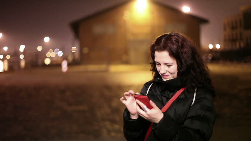Woman using smartphone, night shot -  Full HD, 1920X1080 | Shutterstock HD Video #6086861