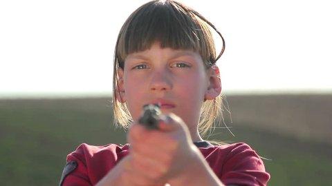 Boy with gun.Boy playing weapon.Little warrior.Teenager a gun aiming.Close up -footage 1920x1080p.
