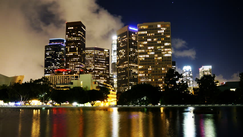 4K Time Lapse of Downtown Los Angeles with Reflection and Storm Clouds -Tilt Up-