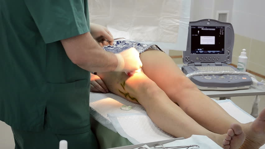 Surgeon operating patient leg