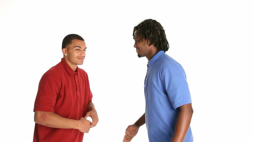 Two young African American men greeting with secret handshake