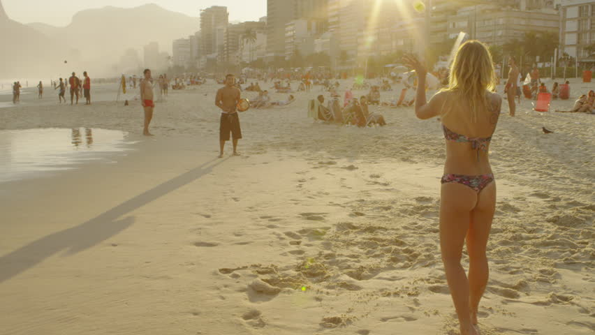 RIO DE JANEIRO, BRAZIL - JUNE 23: Slow motion shot of a couple playing tennis on Ipanema beach at dusk