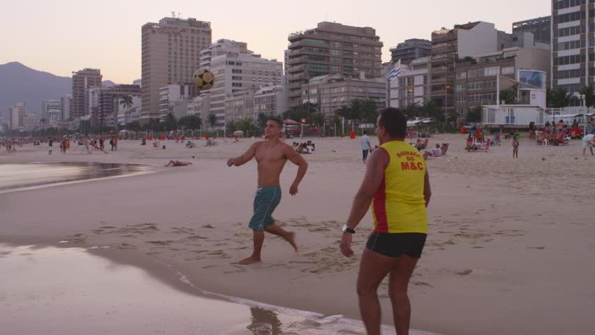 RIO DE JANEIRO, BRAZIL - JUNE: Two men on Ipanema beach playing soccer