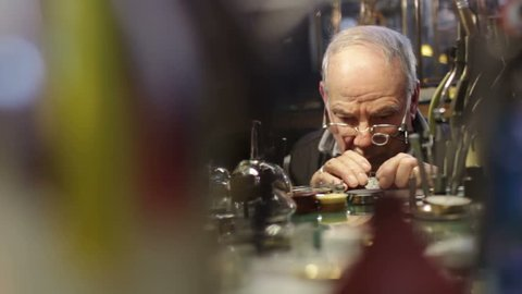 clockmaker checks the operation of a repair