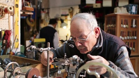 watchmaker working with a antique lathe