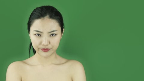 Asian girl naked beauty young adult isolated greenscreen green background upset secret