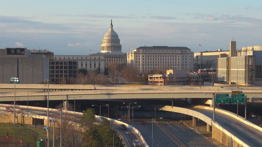 Timelapse of Capitol dome and traffic street, car pass on freeway at sunset in WASHINGTON DC