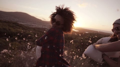 Sunset Pillow fight in slow motion