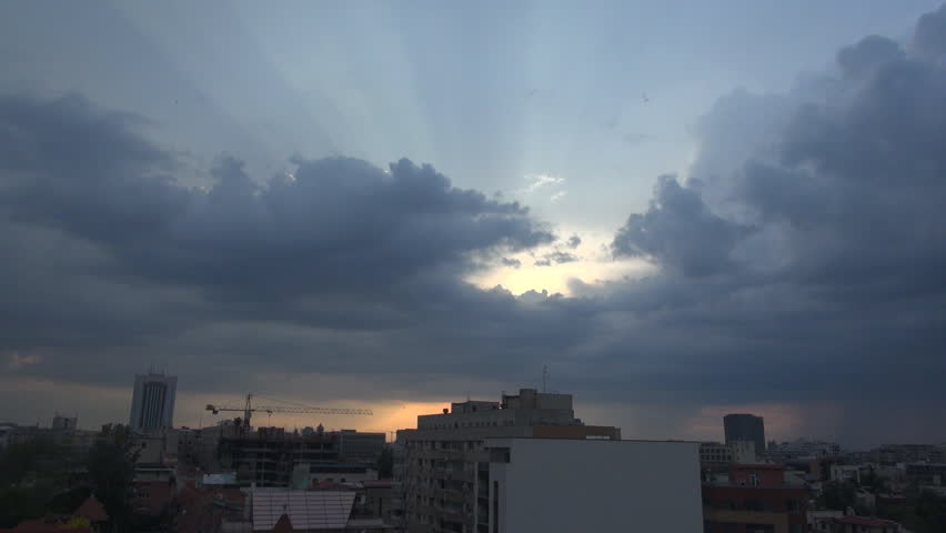 Sun Rays Trough The Clouds, Aerial, Skyline,Down Town Hand Held Camera | Shutterstock HD Video #6271982