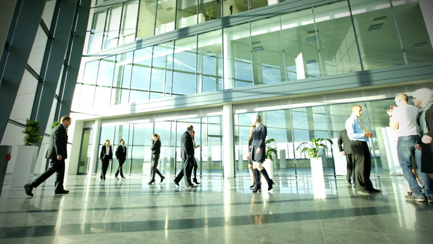 Time lapse of diverse business group in a large modern corporate building | Shutterstock HD Video #6283136