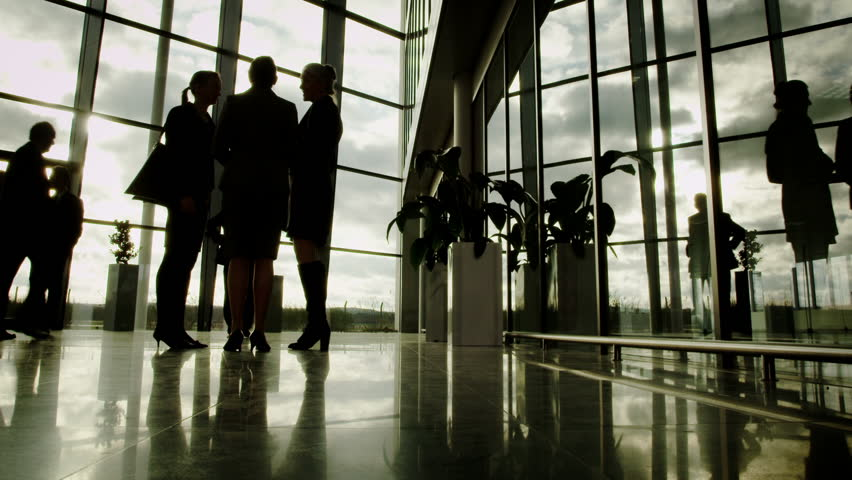 Low angle view of business group walking through large modern office building | Shutterstock HD Video #6284225