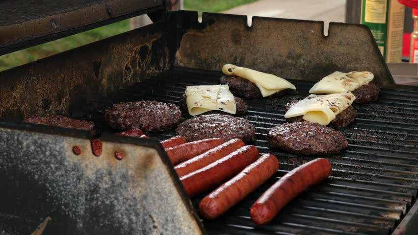 Cooking Burgers and Hot Dogs on the Grill on the 4th of July