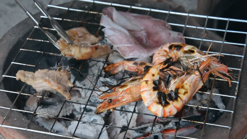 Grilled shrimps ,pork,squid , with flames in background  | Shutterstock HD Video #6308861