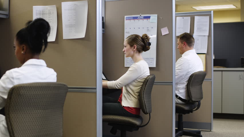 Medium Shot Tired woman working at desk in office