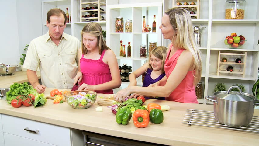 Home Kitchen Cooking healthy caucasian family cooking home kitchen - happy caucasian