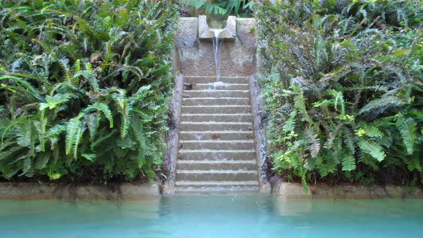 oasis fountain waterfall trickling down steps in paradise garden
