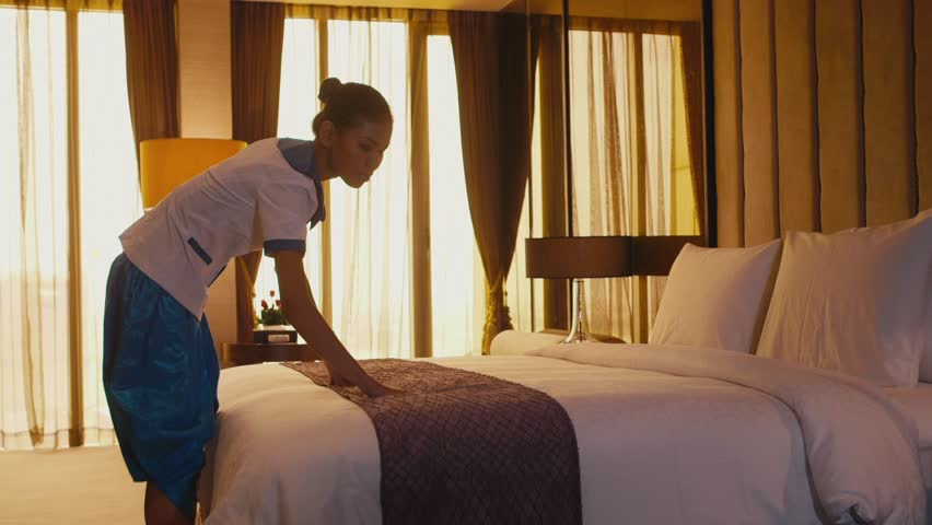 Asian housemaid cleaning hotel room, woman, people working. Girl in resort suite bedroom, setting up bed, staff, employee at work as housekeeper, professions, jobs. 1of5