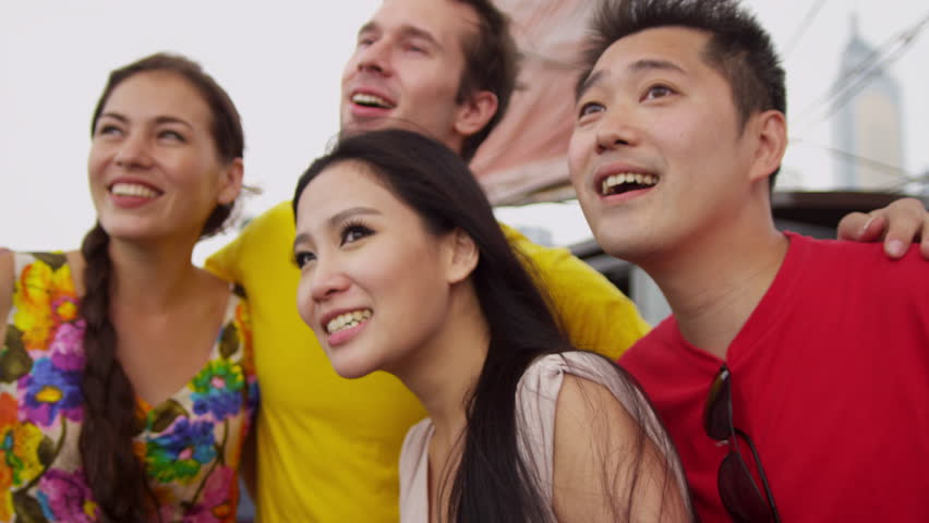 Young Caucasian Asian Chinese people vacation enjoying harbor sightseeing tour sailing aboard traditional designed Chinese junk close up shot on RED EPIC | Shutterstock HD Video #6392171