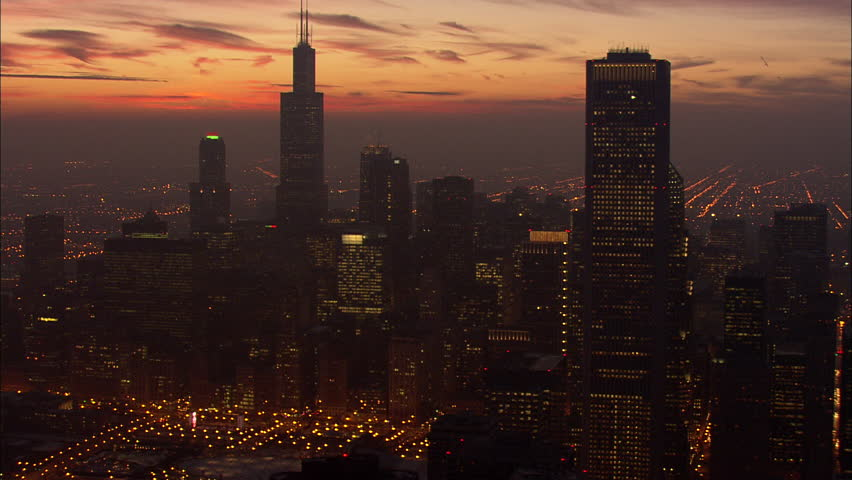Chicago Night Skyscrapers Lake Michigan. View of Chicago and Lake Michigan and Chicago skyline at sunset