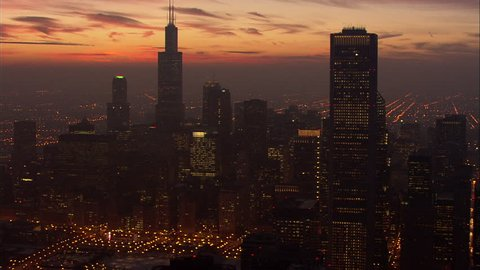 Chicago Night Skyscrapers Lake Michigan. View of Chicago and Lake Michigan and Chicago skyline at sunset