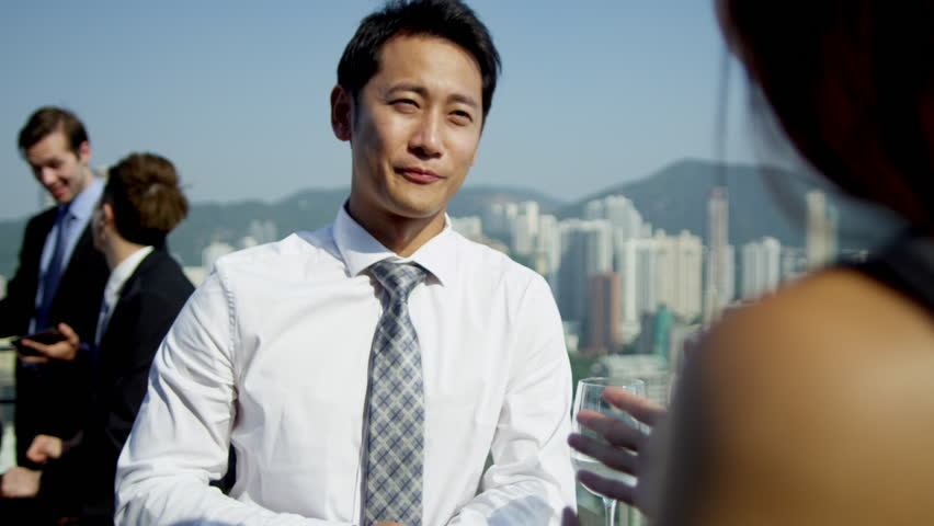 Young ethnic advertising executives talking rooftop bar city downtown multi ethnic colleagues background shot on RED EPIC | Shutterstock HD Video #6434969