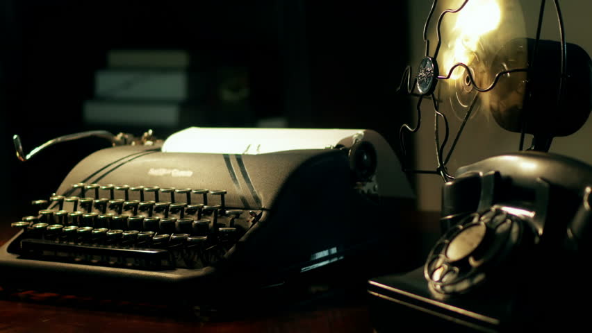 An old manual typewriter and vintage electric fan in dimly lit room. Sepia tone, 4K