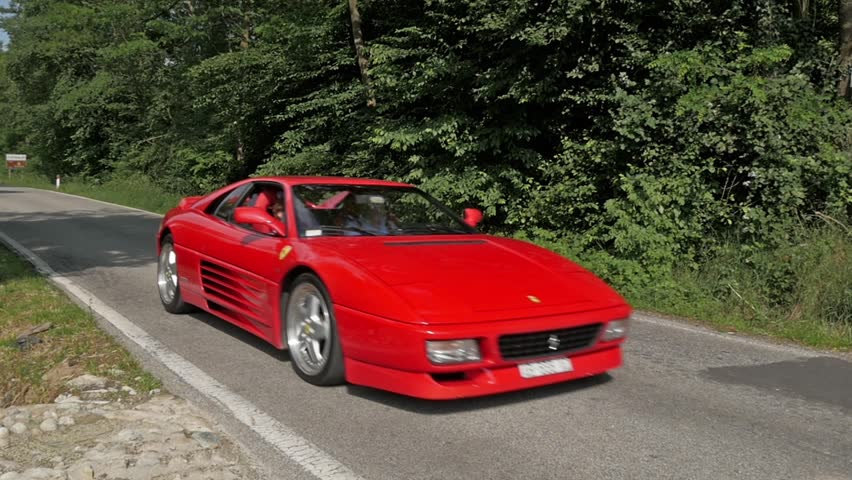Cuorgne', Italy, May 2014. Ferrari Testarossa. It is a 12-cylinder mid-engine sports car manufactured by Ferrari, which went into production in 1984 as the successor to the Ferrari Berlinetta Boxer.