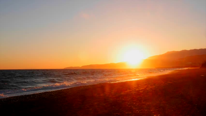 Beautiful time-lapse of a sunset on the beach of spain ,with walking people.   Shutterstock HD Video #6486881