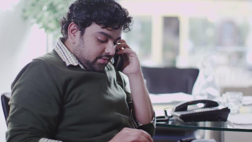 Man on phone in office | Shutterstock HD Video #6495671