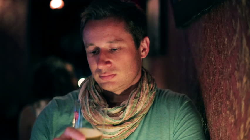 Young man drinking beer in a pub, steadycam shot  | Shutterstock HD Video #6530441