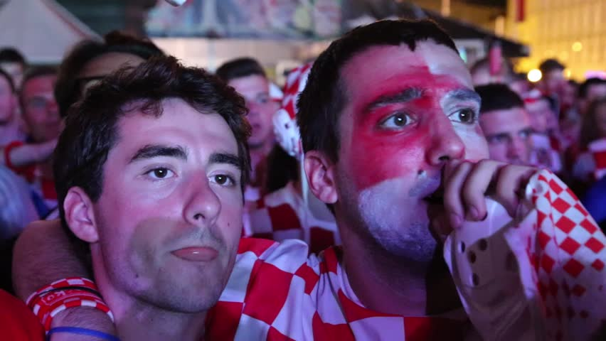 ZAGREB, CROATIA - 12 JUNE 2014. Excited fans on central square of Zagreb during the first world cup match between Croatia and Brazil. Match in which Brazil won three goals to one.
