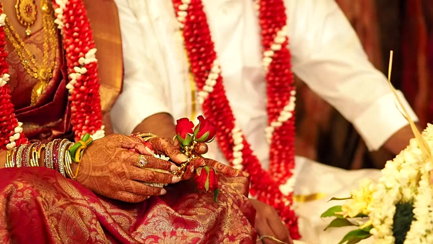 South indian wedding images holding hands