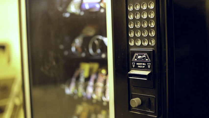 Stock video of buying something from vending machine ...