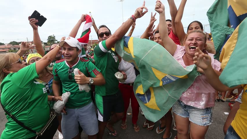 FORTALEZA, BRAZIL - June 16, 2014: Soccer fans waiting for the Brazil national team to arrive for their training at Estadio Castelao one day before Brazil faces Mexico. No Use in Brazil.
