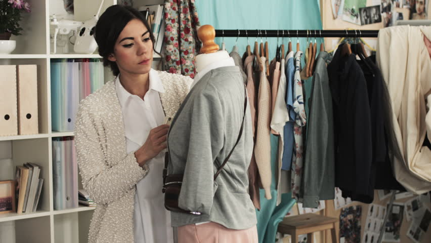 Fashion designer woman taking photograph for e-commerce online store | Shutterstock HD Video #6604292