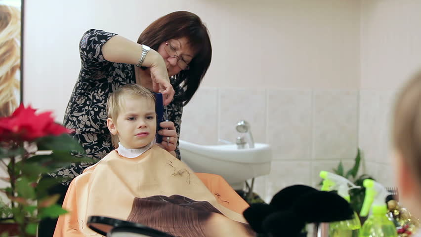 New Hairstyle For Blond Boy Stockvideos Filmmaterial 100
