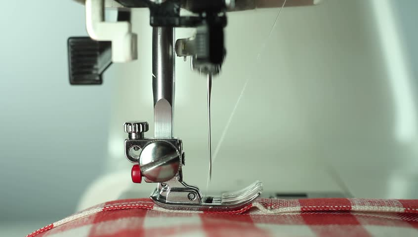 Sewing machine sews fabric close-up. Series of videos.