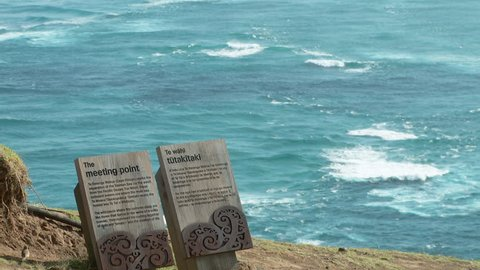 This is the point where the two oceans meet(actually the Tasman sea and the Pacific Ocean)at the northern most point in New Zealand: Cape Reinga. One sign is in English and the other in Maori.