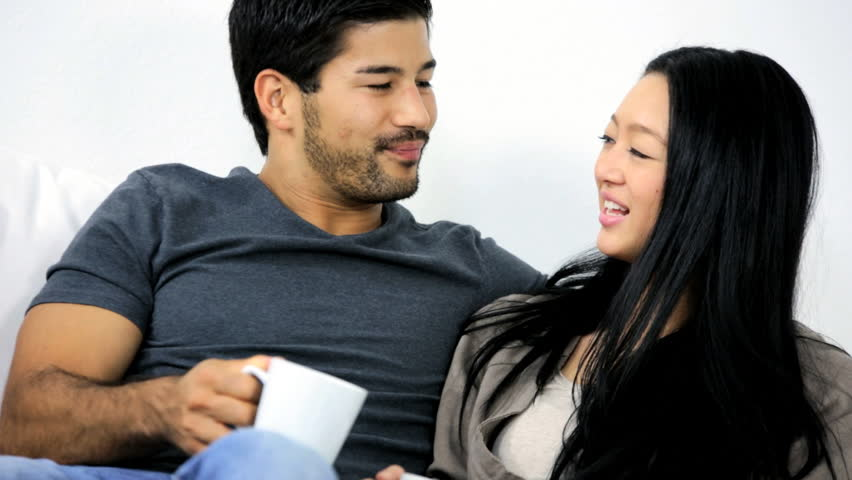 Close Up Happy Casually Dressed Attractive Young Asian Chinese Couple  Enjoying Time Together Talking Drinking Coffee Home Sofa Stock Footage  Video 6655271 | ...