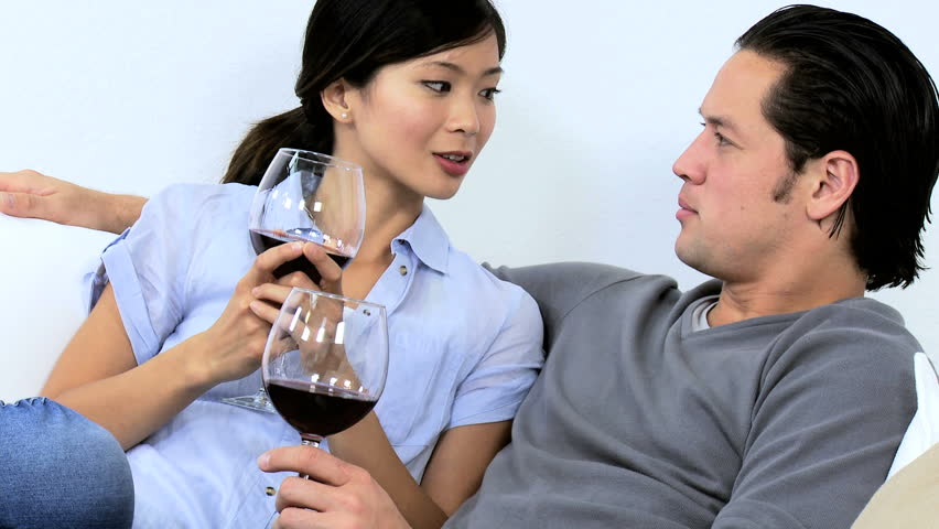 Close Up Casually Dressed Young Asian Chinese Couple Enjoying Time Together  Talking Drinking Glass Wine Home Sofa Stock Footage Video 6665261 |  Shutterstock
