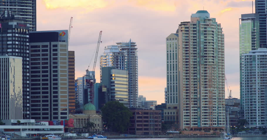 Brisbane City seen over the river from kangaroo point at sunset | Shutterstock HD Video #6683411